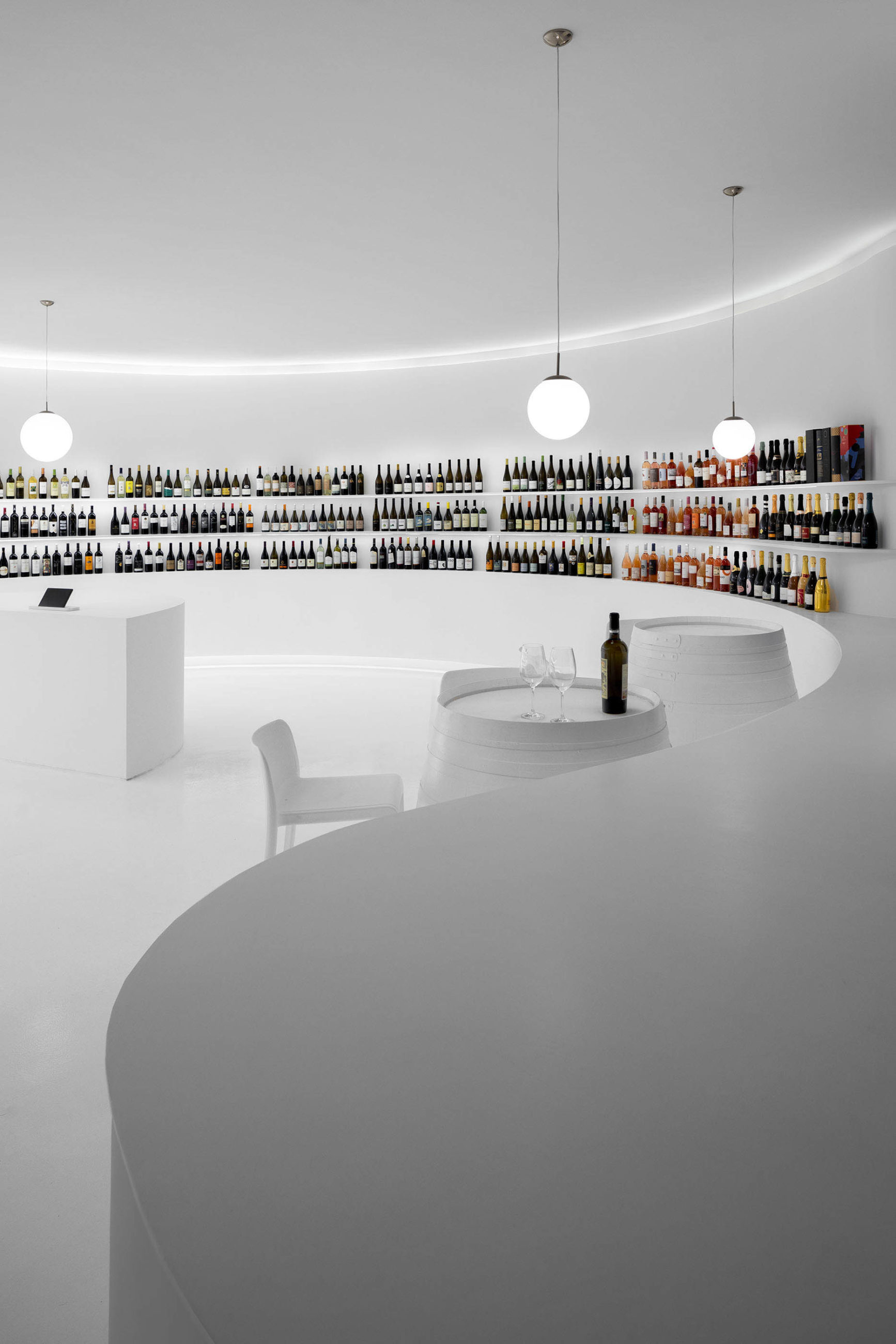 Portugal Vineyards wine store at Hipercentro Areosa in Porto by the architecture office Porto Architects with architectural photography by Ivo Tavares Studio